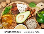 foods rich in vitamin e such as ... | Shutterstock . vector #381113728