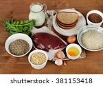 Small photo of Foods Highest in Thiamin (Vitamin B1) on a wooden background. Top view