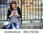 beautiful young woman looking... | Shutterstock . vector #381170236