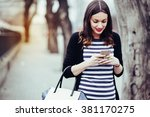 beautiful young woman looking... | Shutterstock . vector #381170275