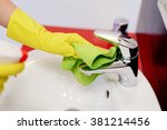 female hands with rubber... | Shutterstock . vector #381214456