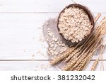 oat flakes on wooden table... | Shutterstock . vector #381232042