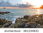 Stock photo natural rock with strong water wave and sunrise background at belanak beach lombok indonesia 381234832