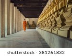 monk walk in the temple with...   Shutterstock . vector #381261832