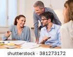 happy businesspeople during a... | Shutterstock . vector #381273172