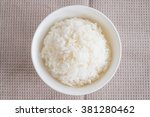 rice in white bowl  top view | Shutterstock . vector #381280462