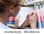 administrator looking at... | Shutterstock . vector #381286216