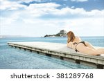 pier sea sky and woman  | Shutterstock . vector #381289768
