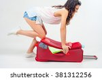 young woman packs her things ... | Shutterstock . vector #381312256