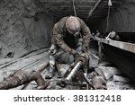 Miner In A Mine