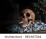 Small photo of Still Life, Skull on pile of cigarette butt / danger, abominate