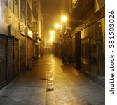 Small photo of dark alley, Seville, Spain