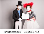 Two Mimes With A Sign For...