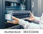 it engineer installs enclosure... | Shutterstock . vector #381522646