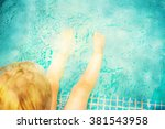 baby sitting near swimming pool. | Shutterstock . vector #381543958