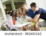 young multiracial friends at... | Shutterstock . vector #381601162