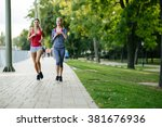 two women jogging in park and... | Shutterstock . vector #381676936
