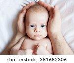 baby in father's hands. happy... | Shutterstock . vector #381682306