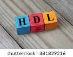 Small photo of HDL (High-density lipoprotein) acronym on colorful wooden cubes
