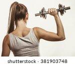 strong woman lifting dumbbells...   Shutterstock . vector #381903748