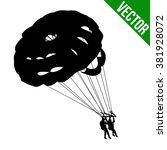 couple parasailing silhouette...