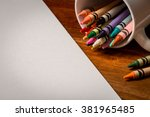 crayons in a white mug on a... | Shutterstock . vector #381965485