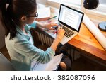 young female blogger working at ... | Shutterstock . vector #382087096