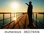 man on pier photograph morning... | Shutterstock . vector #382176436