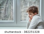portrait of a pensive young... | Shutterstock . vector #382251328