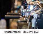 prepares coffee in his coffee... | Shutterstock . vector #382291162
