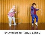 two senior women exercising... | Shutterstock . vector #382312552