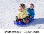 little laughing boys on sledge... | Shutterstock . vector #382346086