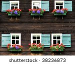 Two Rows Of Windows With Flower ...