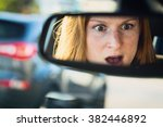 scared or shocked female driver ... | Shutterstock . vector #382446892