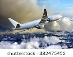 white aircraft in the sky. the... | Shutterstock . vector #382475452