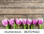 Lovely Tulip Flowers On Wooden...
