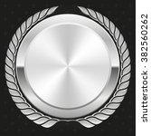 glossy silver badge on black... | Shutterstock .eps vector #382560262