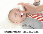 baby getting medicine through... | Shutterstock . vector #382567936