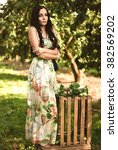 woman in colorful maxi dress... | Shutterstock . vector #382569202