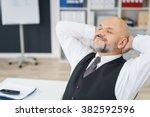 contented businessman relaxing... | Shutterstock . vector #382592596