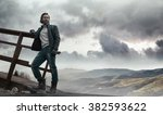 handsome dark haired guy restin ... | Shutterstock . vector #382593622