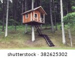 remote wooden tree house in the ... | Shutterstock . vector #382625302