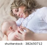 mom and baby | Shutterstock . vector #382650712