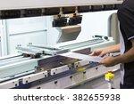 operator bending metal sheet by ... | Shutterstock . vector #382655938
