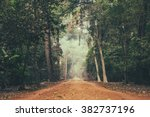 dirt road stretching through... | Shutterstock . vector #382737196