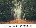 dirt road stretching through... | Shutterstock . vector #382737196
