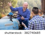 two smiling adult male drivers... | Shutterstock . vector #382740685