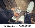 selfie of drink water with shoes | Shutterstock . vector #382862512