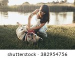 Girl Playing With Dog On Grass