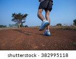 runner feet running on road | Shutterstock . vector #382995118
